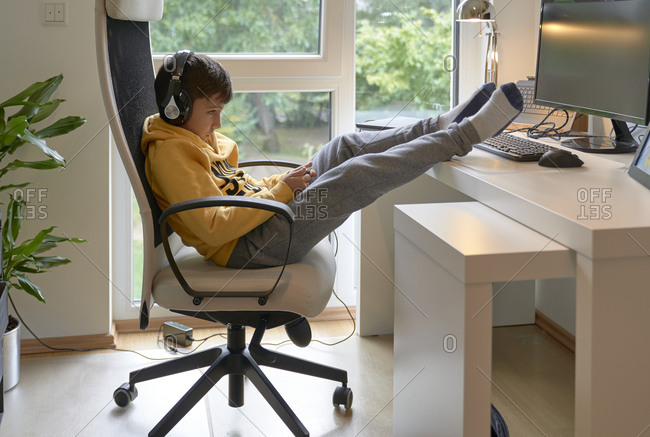 Child using his mobile in the office
