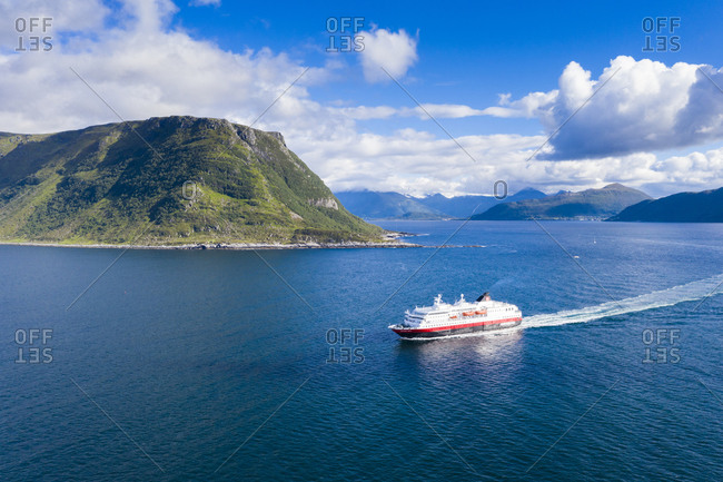 Norway, More og Romsdal, Alesund - July 4, 2019: Aerial view of Hurtigruten ship along the fjord, Alesund, Norway