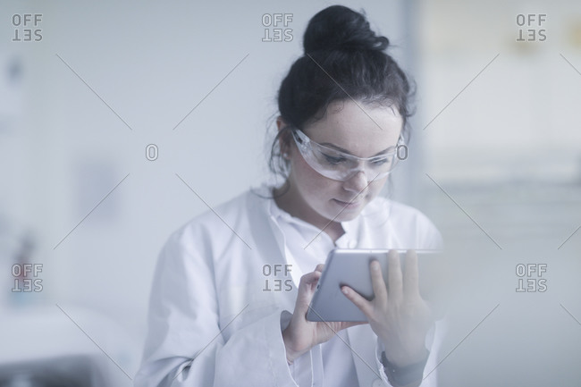 Young scientist female with tablet in a laboratory