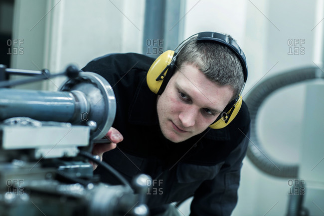 Engineer in a workshop looking to machine
