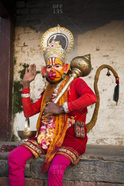 Nepal, Central Development Region, Kathmandu - October 22, 2013: A man dressed as a Hindu god at Pashupatinath temple, Kathmandu
