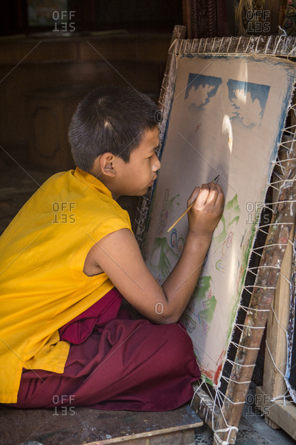 Nepal, Central Development Region, Kathmandu - October 23, 2013: A young Nepalese boy works on a painting in Bhaktapur, near Kathmandu