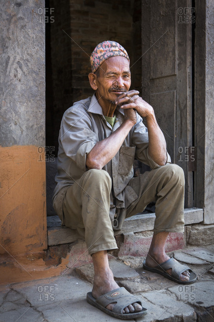 Nepal, Central Development Region, Kathmandu - October 23, 2013: A man in a traditional hat poses for a portrait in Kathmandu, Nepal.