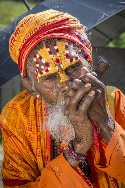 Nepal, Central Development Region, Kathmandu - October 23, 2013: A sadhu, a Hindu holy man, at Pashupatinath temple in Kathmandu, Nepal.