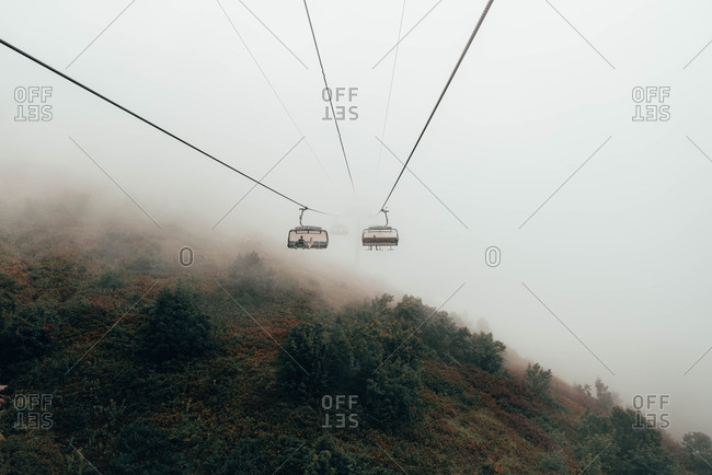 Cable car in the foggy forest