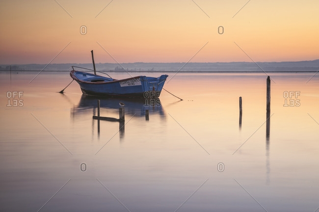 Portugal, Aveiro District, Aveiro - March 23, 2019: wooden boat at sunrise