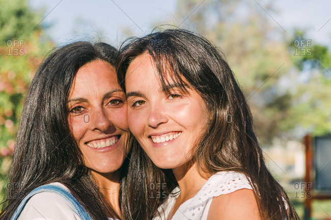 Portrait of mother and daughter side by side.