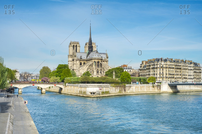 France, �le-de-France, Paris - April 7, 2014: Notre Dame Cathedral on the banks of the Seine River, Paris, France