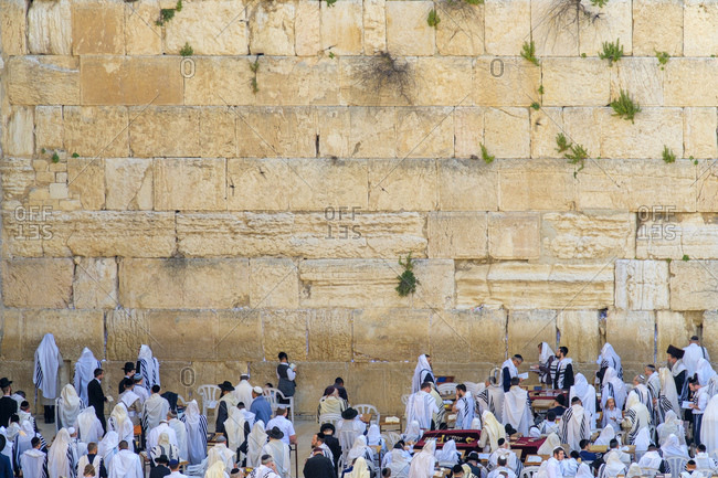 Israel, Jerusalem District, Jerusalem - April 27, 2019: Jewish men praying at the Western Wall on the last day of Passover