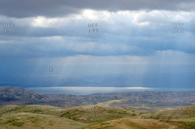 Sunbeams through storm clouds over the Dead Sea, Judean Desert, West Bank, Palestine