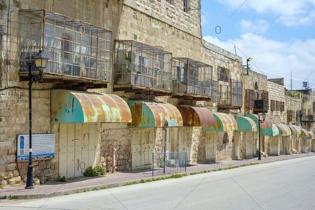 Palestine, West Bank, Hebron - April 5, 2019: Empty shops and buildings on Shuhada Street, Hebron, West Bank, Palestine