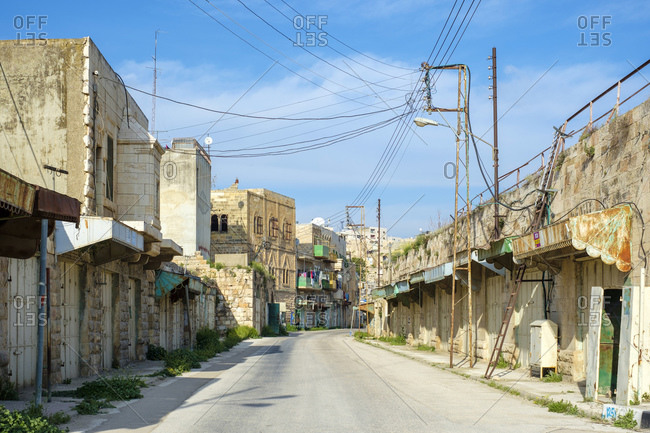 Empty shops and buildings on Shuhada Street, Hebron, West Bank, Palestine