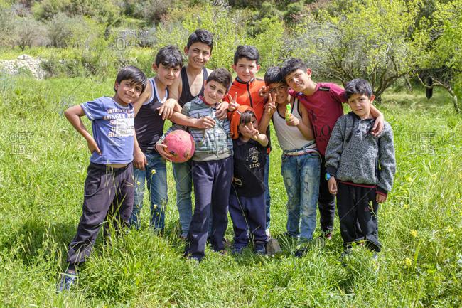 Palestine, West Bank, Kfar Tapuach - April 6, 2019: Palestinian children play in a field near Hebron, West Bank, Palestine