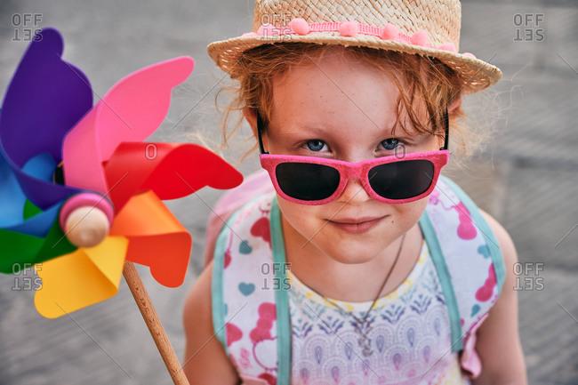 Cute child with pinwheel