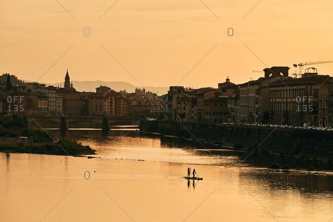Picturesque quay of European city and bridge in dawn