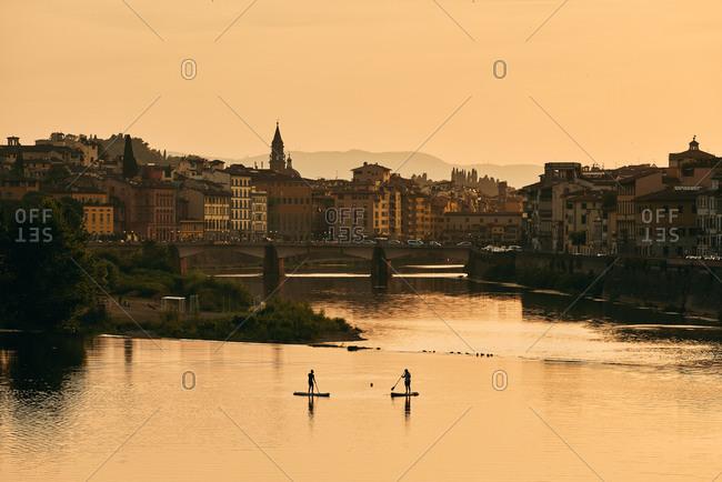 Scenic harbor of European city and bridge in dawn