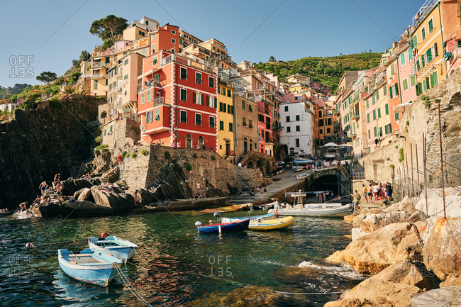 Italy, Liguria, Riomaggiore - June 23, 2019: Picturesque European town with peaceful bay