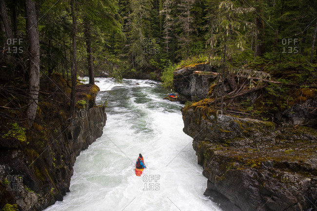 A white water kayaker paddles down the Cheakamus River in Whistler.