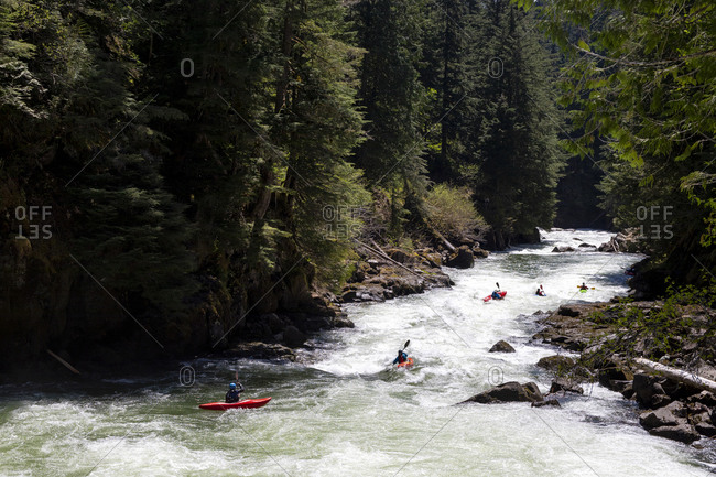A group of whitewater kayakers paddle down the Callaghan creek.