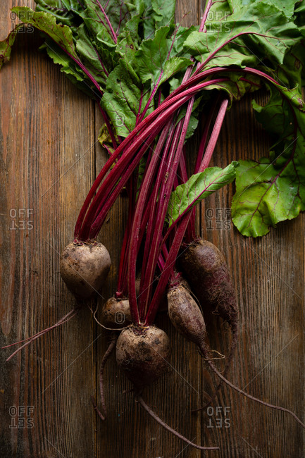 Bunch of beets on wooden surface