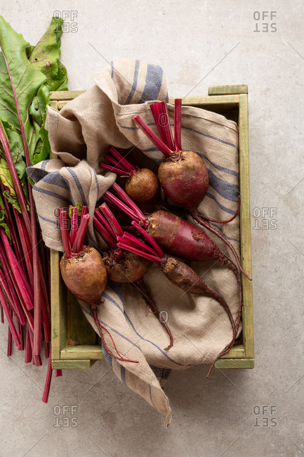 Beetroots and leaves in crate
