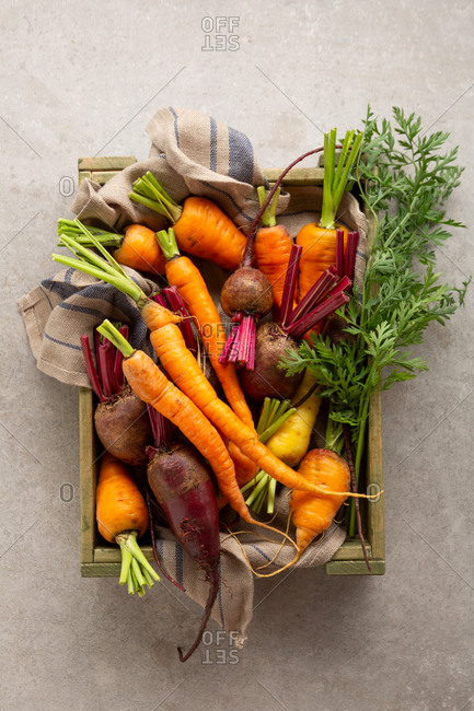 Carrots and beets in a wooden crate