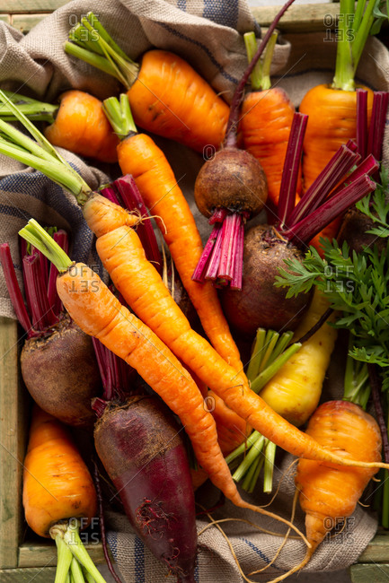 Carrots and beets in a wooden crate from above