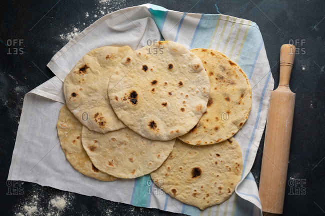 Overhead view of flat breads on cloth