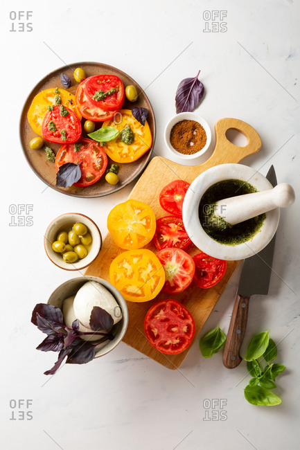 Overhead view of tomato salad and ingredients