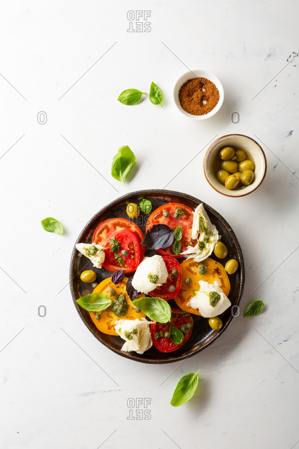 Fresh tomato and cheese salad on white background