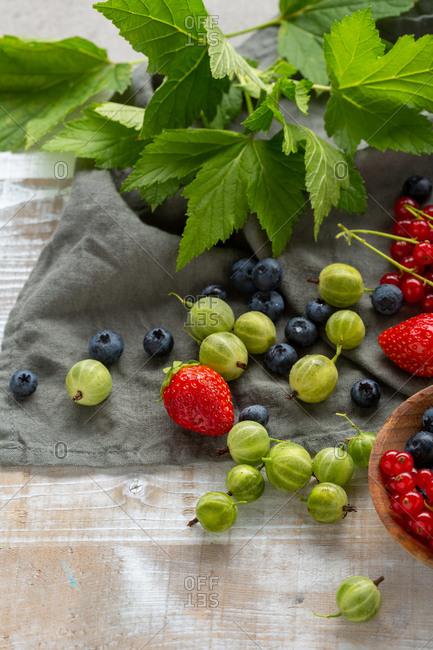 Variety of fresh berries on gray cloth