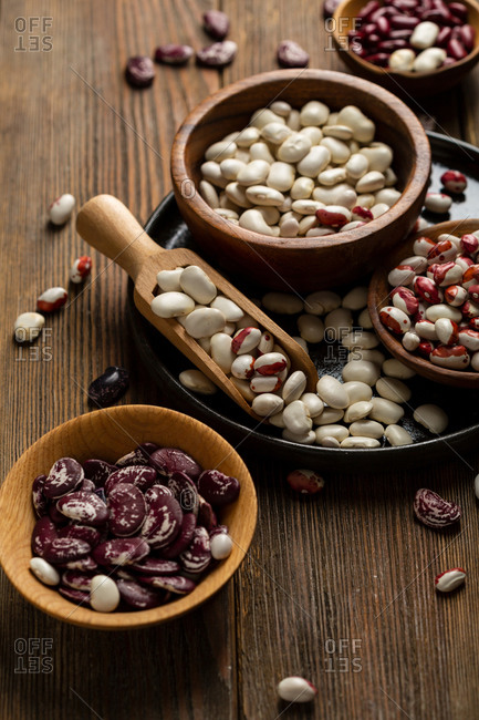 Variety of raw bean on wooden surface close up
