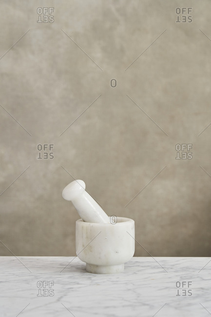 Marble mortar and pestle on kitchen counter