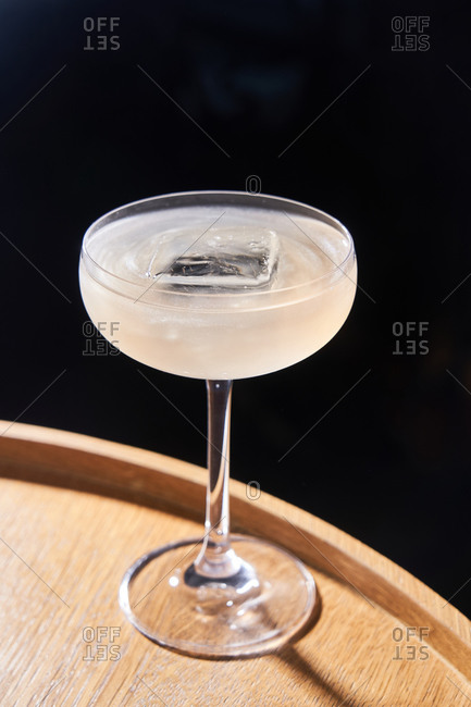 Cocktail on ice in a coupe glass