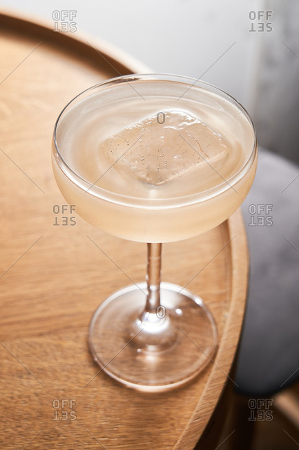 Clear cocktail on ice in a coupe glass