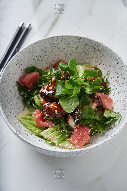 Squid with grapefruit salad