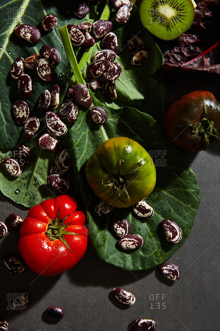Variety of healthy produce on dark background