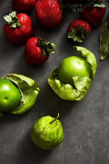 Colorful fresh fruit on gray background