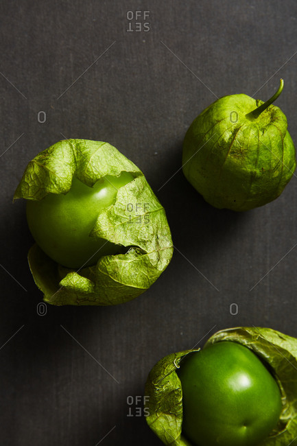 Green tomatillos on gray background