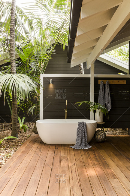 Modern soaker tub on deck of a spa