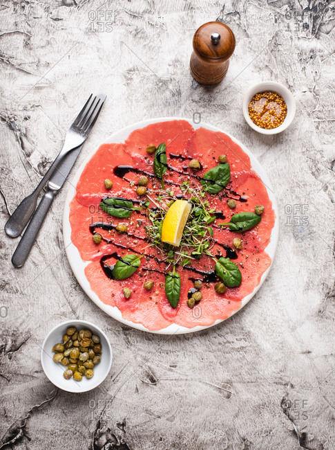 Beef carpaccio with capers and fresh spinach