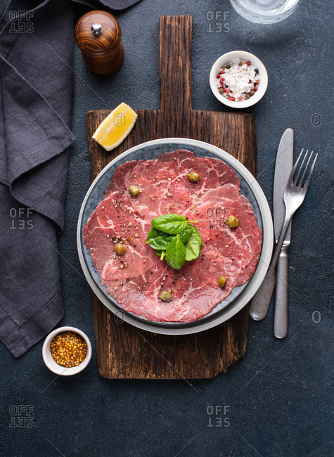Overhead view of Beef Carpaccio seasoned with pepper