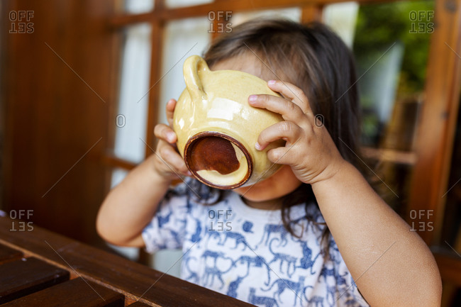 Little girl drinking from a tea cup