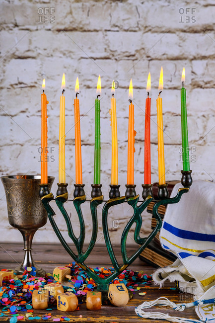 Closeup of a burning Chanukah candlestick on menorah