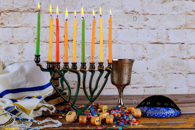 Lighting candles in menorah for Hanukkah
