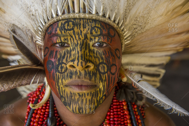 Brazil, Bahia - July 28, 2016: Indigenous with face painting and traditional clothes