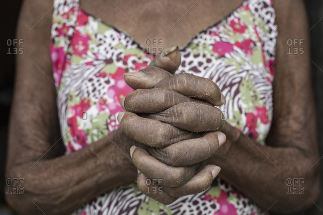 Senior afro-Brazilian woman with joined hands