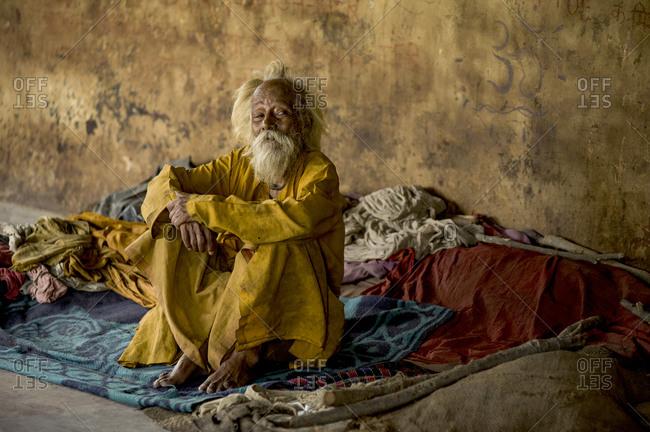 India, Uttar Pradesh, Varanasi - July 10, 2011: Old man with terminal illnesses at mukti bhawan, indian death hotels