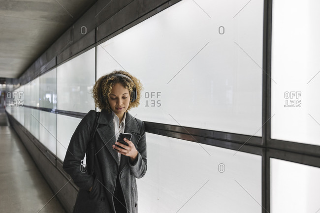 Woman with headphones and smartphone