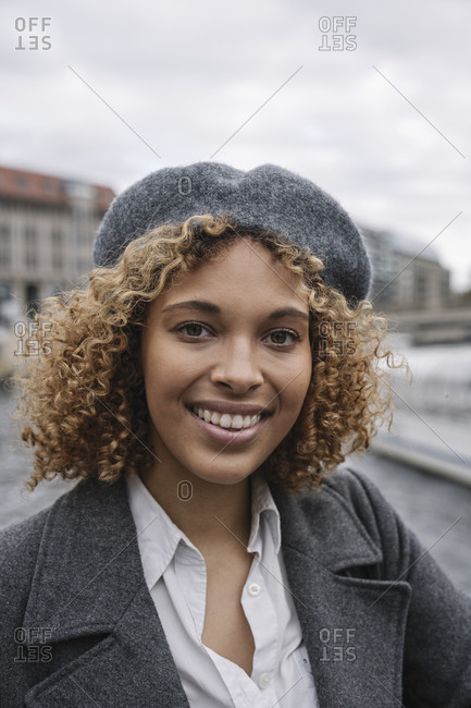 Portrait of happy young woman in the city- Berlin- Germany